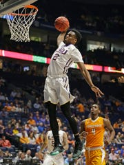 LSU's Antonio Blakeney (2) dunks as Tennessee's Armani Moore (4) looks on during the second half of an NCAA college basketball game in the Southeastern Conference tournament in Nashville, Tenn., Friday.  LSU won 84-75.