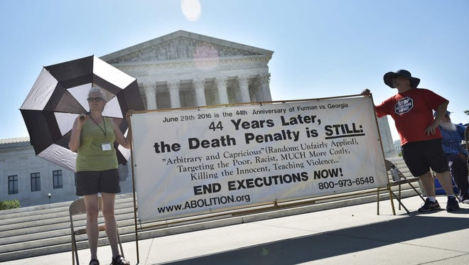 Activists protest the death penalty in June 2016, a year after the Supreme Court upheld the use of a  lethal injection method.