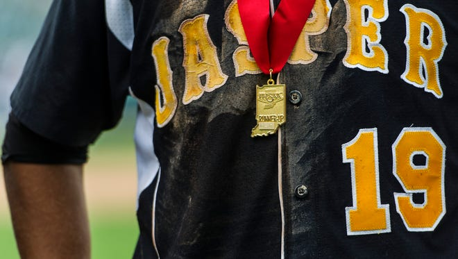 Jasper's Evan Aders (19) wears a runner-up medal after the Wildcats lost to the Class 3A state championship to the South Bend St. Joseph Indians at Victory Field in Indianapolis, Ind., on Saturday, June 17, 2017. The St. Joseph Indians shut out the Jasper Wildcats, 4-0.