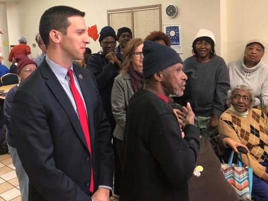 Councilman P.G. Sittenfeld with seniors at the Over-the-Rhine Senior Center. He pulled together a plan to help center stay open. In the new budget, council added seniors to the list of those eligible for human services funding and included $111,000 for the salary and benefits of a chief advocacy officer for aging and accessibility.