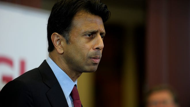 Louisiana Gov. Bobby Jindal announces the opening of a technology center by CGI Federal at a new research park owned by UL Lafayette during a press conference at the Lafayette Economic Development Authority in Lafayette, Monday, April 28, 2014.