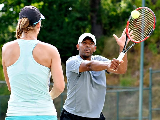 Punch Maleka, right, is shown in a file photo with Charlotte Sikora. The two players will attempt to defend their title this weekend at the Mixed Doubles Charity Classic at the Country Club of York.