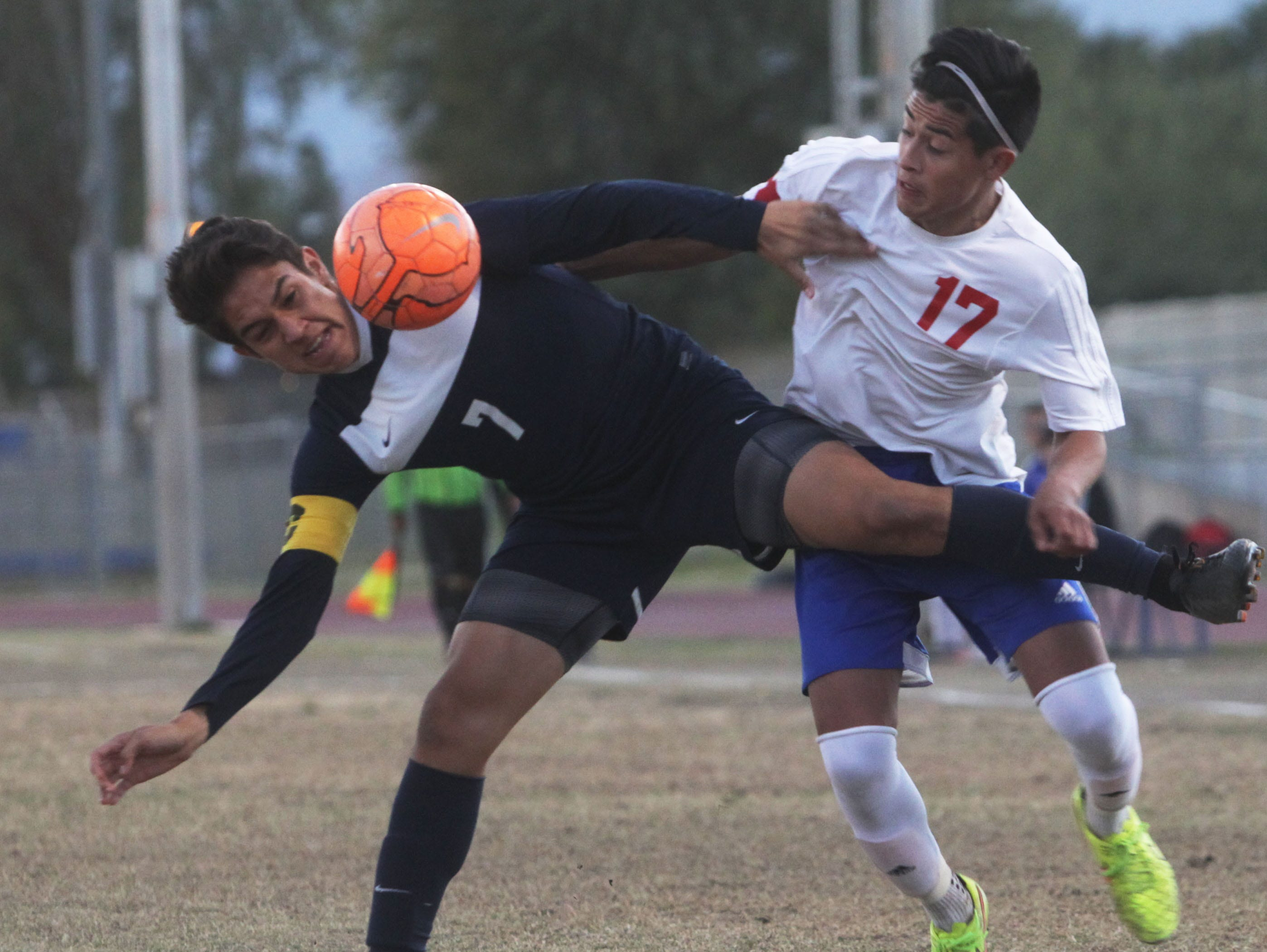 At far right, Indio High School's Jonathan Tremper battles for the ball against La Quinta High School's Sergio Gonzalez at Indio. Indio won the game 2-1 handing La Quinta their first loss.