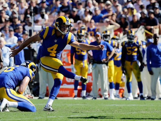 Los Angeles Rams kicker Greg Zuerlein, right, kicks a field goal during the second half of an NFL football game against the Seattle Seahawks at the Los Angeles Memorial Coliseum, Sunday, Sept. 18, 2016, in Los Angeles. (AP Photo/Jae Hong)