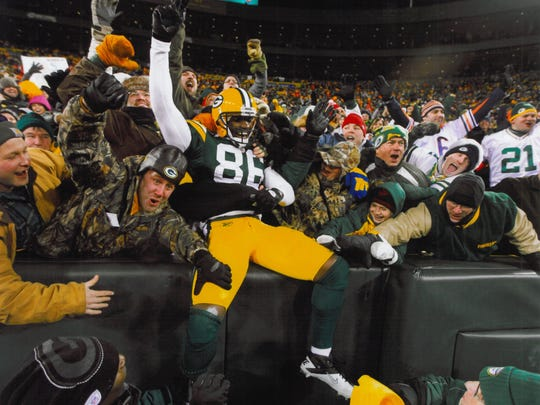 The original photo of the Donald Lee Lambeau Leap. Augie is the little boy near Lee's knee, and Doug is behind him, yelling in the green, yellow and white Packer hat.