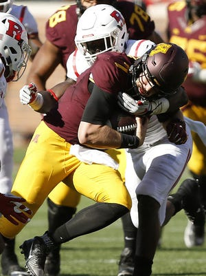 Minnesota quarterback Mitch Leidner is tackled by Rutgers linebacker Trevor Morris during the second half Saturday in Minneapolis. Minnesota won 34-32.
