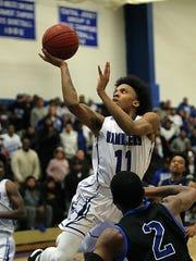Carteret's Jahlil Nix goes up for a basket against