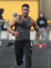 Southeast Polk's Gavin Williams competes in the 100-meter dash. Southeast Polk High School hosted the Ram Invitational on March 27.