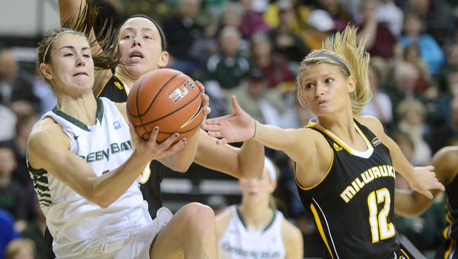 UWGB guard Kaili Lukan hauls a rebound away from UW-Milwaukee guard Kelsey Cunningham in the first half at the Kress Events Center in Green Bay.