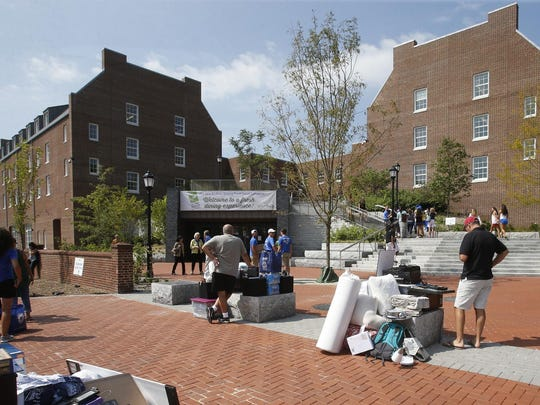 The Caesar Rodney Hall sees its first influx of freshmen as it opens for move day at the University of Delaware campus Saturday.
