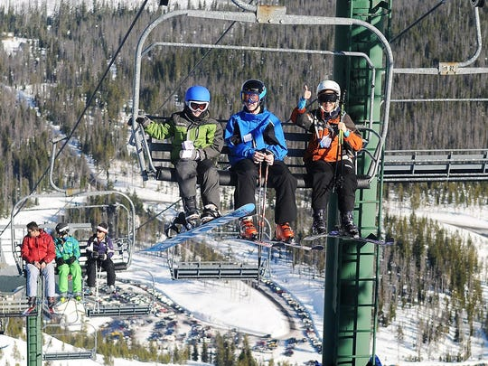 Skiers and snowboarders ride the lifts at Hoodoo ski area on Jan. 19, 2013.