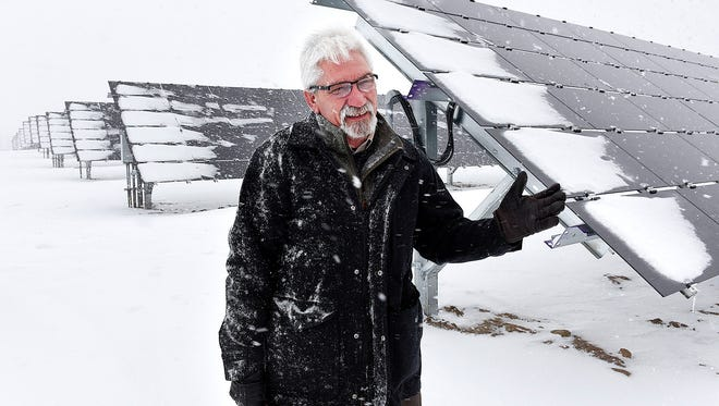 Tom Kroll, director of the St. John's Arboretum, describes the power output of the new solar panels Tuesday, Jan.10, at the St. John's University solar farm in Collegeville. The newest expansion can power about 525 homes.