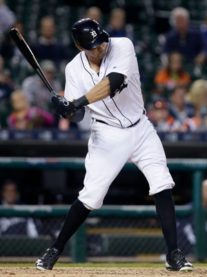 Tigers third baseman Nick Castellanos, in his first game since breaking his left hand on Aug. 6, hits a double during the eighth inning of the Tigers' 12-0 win over the Indians Tuesday at Comerica Park.