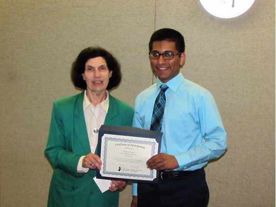 "Mayor Janice S. Mironov makes presentation to East Windsor Regional School District Hightstown High School 2018 graduate Ali Raza Husaini, winner of the 2018 New Jersey League of Municipalities ""Louis Bay 2nd Future Municipal Leaders"" $1,000 Scholarship award."