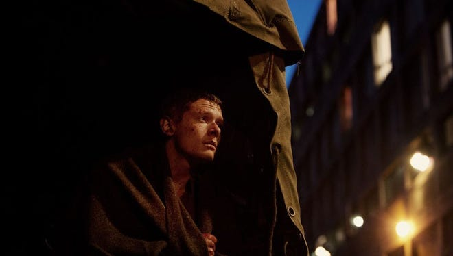 """Jack O'Connell plays a British soldier trapped alone behind enemy lines in """"'71."""""""