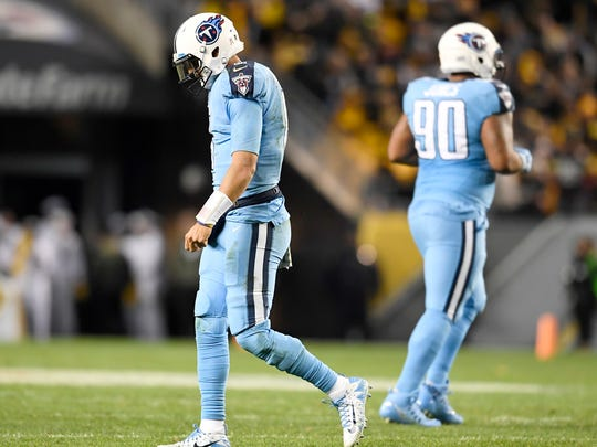Titans quarterback Marcus Mariota (8) walks off the field after being sacked in the third quarter at Heinz Field Thursday, Nov. 16, 2017 in Pittsburgh, Pa.