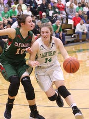 Margaretta's Jayden Moore drives to the basket against Oak Harbor's Logan Harris.