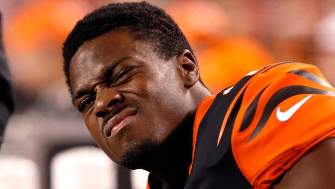 Cincinnati Bengals wide receiver A.J. Green (18) reacts on the bench in the first half against the Denver Broncos at Paul Brown Stadium.