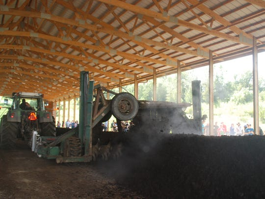 A large tractor-drawn compost turner makes quick work of rotating a pile of dairy heifer manure and bedding on Endres Berryridge Farm, during a farm tour that was part of the North American Manure Expo this week. The Endres farm went into composting in a big way a year ago.