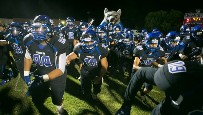Chandler High players take the field before the start of their high school football game against Hamilton High at Chandler High School in Chandler on Friday, Oct. 30, 2015.