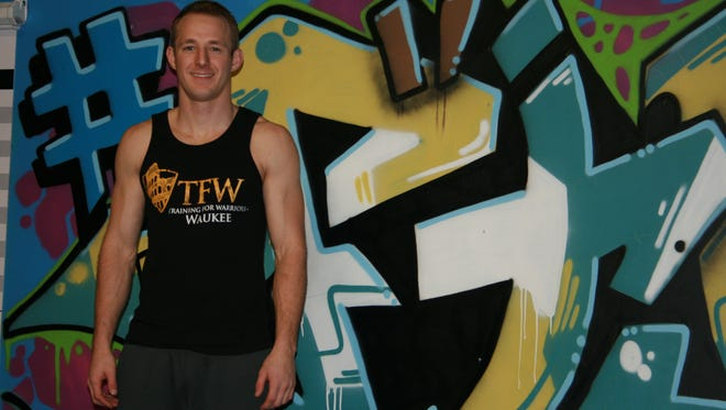Eric Howser, head trainer at Elite Edge Gym in Waukee, poses for a photo on Thursday, Feb. 4, 2016. He helped develop the exercise regime for 6 for '16.