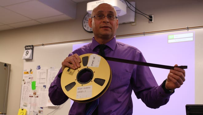 Mark Buza gives a lesson on the evolution of sound recording technology to his living environment class.