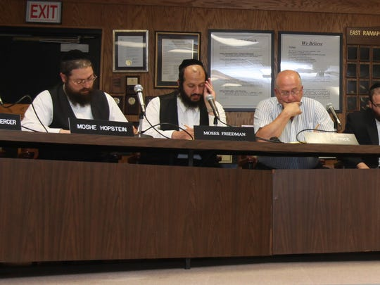 The East Ramapo school board during the reorganization meeting of the board at district headquarters in Chestnut Ridge July 10, 2012.