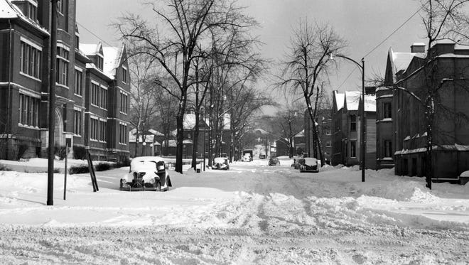 Snow on Shinnick Street in front of Lash High School in 1950.