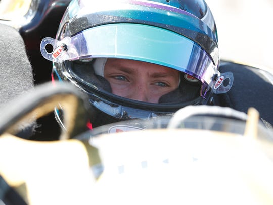 Aaron Telitz sits in James Hinchcliffe's Indy car,