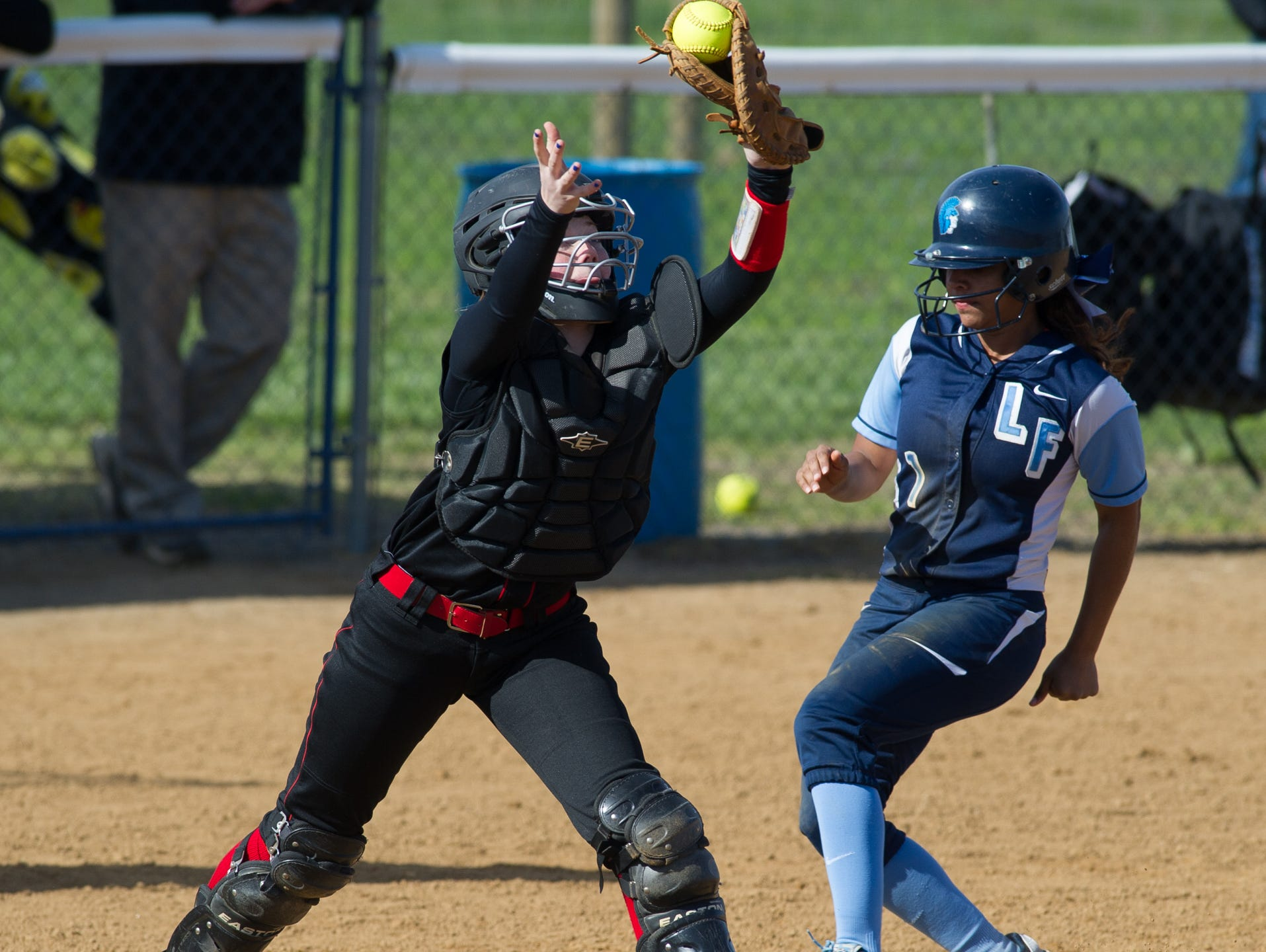 Red Lion's catcher Madelyn Beres (18) tags out Lake Forest's Mya Maddox (1) out at home plate.