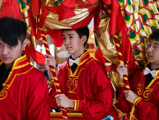 Young men in traditional Chinese clothing make up the