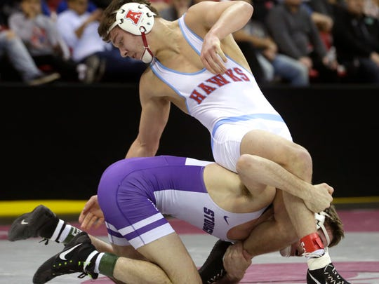 Arrowhead's Joshua Otto (right) is shown during his 8-2 loss to Stoughton's Garrett Model in the 145-pound Division 1 semifinal.