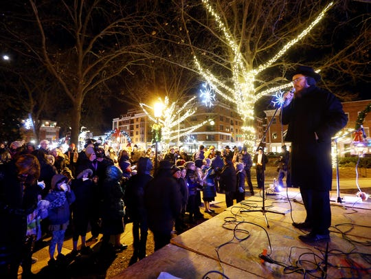 Rabbi Moshe Gurevich speaks during the annual Menorah