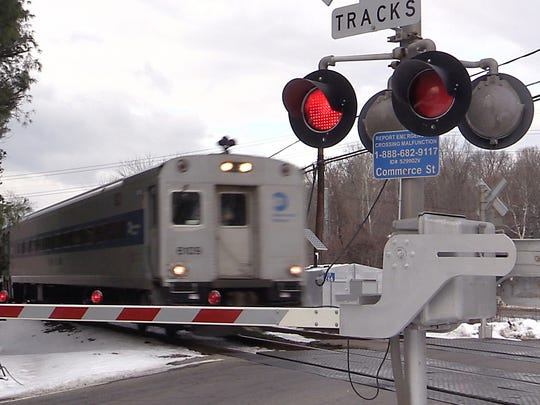 A Metro-North commuter train passes through the Commerce