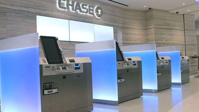 Four ATMs lined up inside a Chase banking branch.