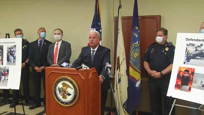 U.S. Attorney James P. Kennedy announces federal charges will be filed against several people arrested after violence broke out after a protest in the city of Rochester in May.