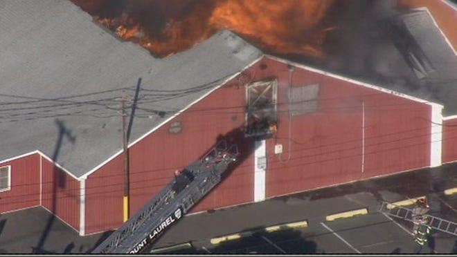 The fire appeared to be contained to Building 4, according to Springfield Mayor Denis McDaniel, who was at the scene.