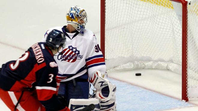 Rochester's Matt Hackett, right, checks behind him only to find the puck in the back of the net as Alexey Marchenko scored to give Grand Rapids a 2-0 lead. The defending Calder Cup-champion Griffins won 8-1.