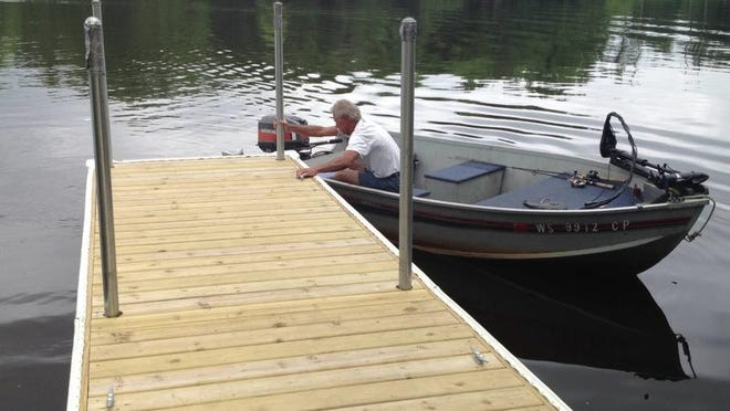 Bob Arbeiter, 56, from Montello docking his boat on the newly updated Galecke Park dock.
