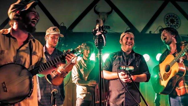 "Bluegrass band Horseshoes & Hand Grenades is releasing its fifth album, ""Miles in Blue,"" on Wednesday, the day before Thanksgiving."