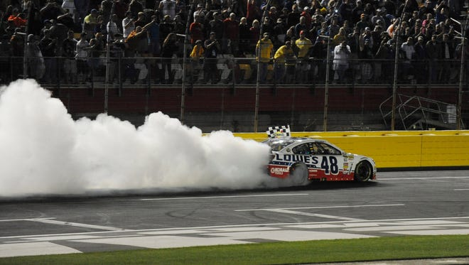 Jimmie Johnson does a burn out after winning the 2013 Sprint All-Star Race at Charlotte Motor Speedway on May 18.