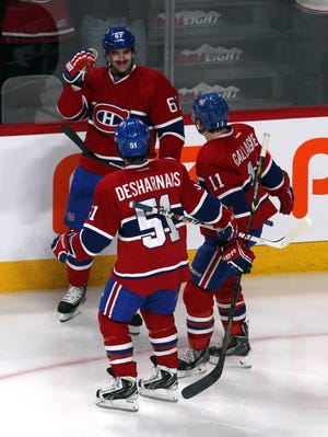 Montreal Canadiens left wing Max Pacioretty (67) celebrates with teammates after scoring a goal against the Pittsburgh Penguins during the second period at Bell Centre.