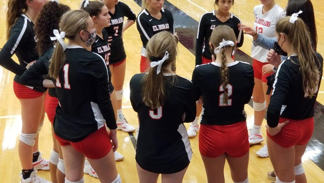El Dorado volleyball coach, Alyssa Rawlingsm directs her team during a timeout in the Wildcat's match against Buhler on Tuesday, Sept. 15 at El Dorado High School.