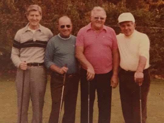 Bob Crouch (second from right) with good friend Gary Player (right) in the early 1990s.