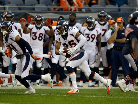 Denver Broncos cornerback Chris Harris (25) runs to the end zone for a touchdown after intercepting a pass during the first half of an NFL preseason football game against the Chicago Bears, Thursday, Aug. 10, 2017, in Chicago. (AP Photo/Nam Y. Huh)