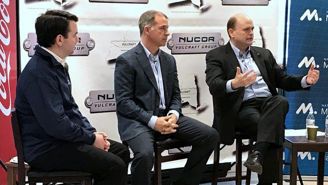 U.S. Rep. Tom Reed, right, talks about the impact the tax reform bill will have on manufacturing during a town hall meeting Tuesday at Vulcraft of New York in Chemung. Joining Reed are Keith Smith, left, from the National Association of Manufacturers, and Chad Utermark, executive vice president of Vulcraft's parent company Nucor.