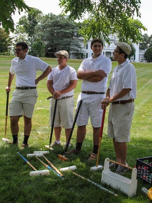 Rutgers Preparatory School croquet team answer questions during a demonstration of croquet at the Frelinghuysen Arboretum in Morris Township on August 2, 2015. (Alexandra Pais / The Daily Record)