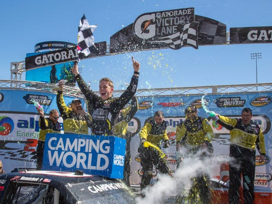 NASCAR Camping World Truck Series drivercelebrates in Victory Lane after winning the Alpha Energy Solutions 250 at Martinsville Speedway in Martinsville, Va., Monday, March 26, 2018. (AP Photo/Matt Bell)