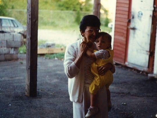 Babe Economou holds her granddaughter, Kostadina Donnelly.