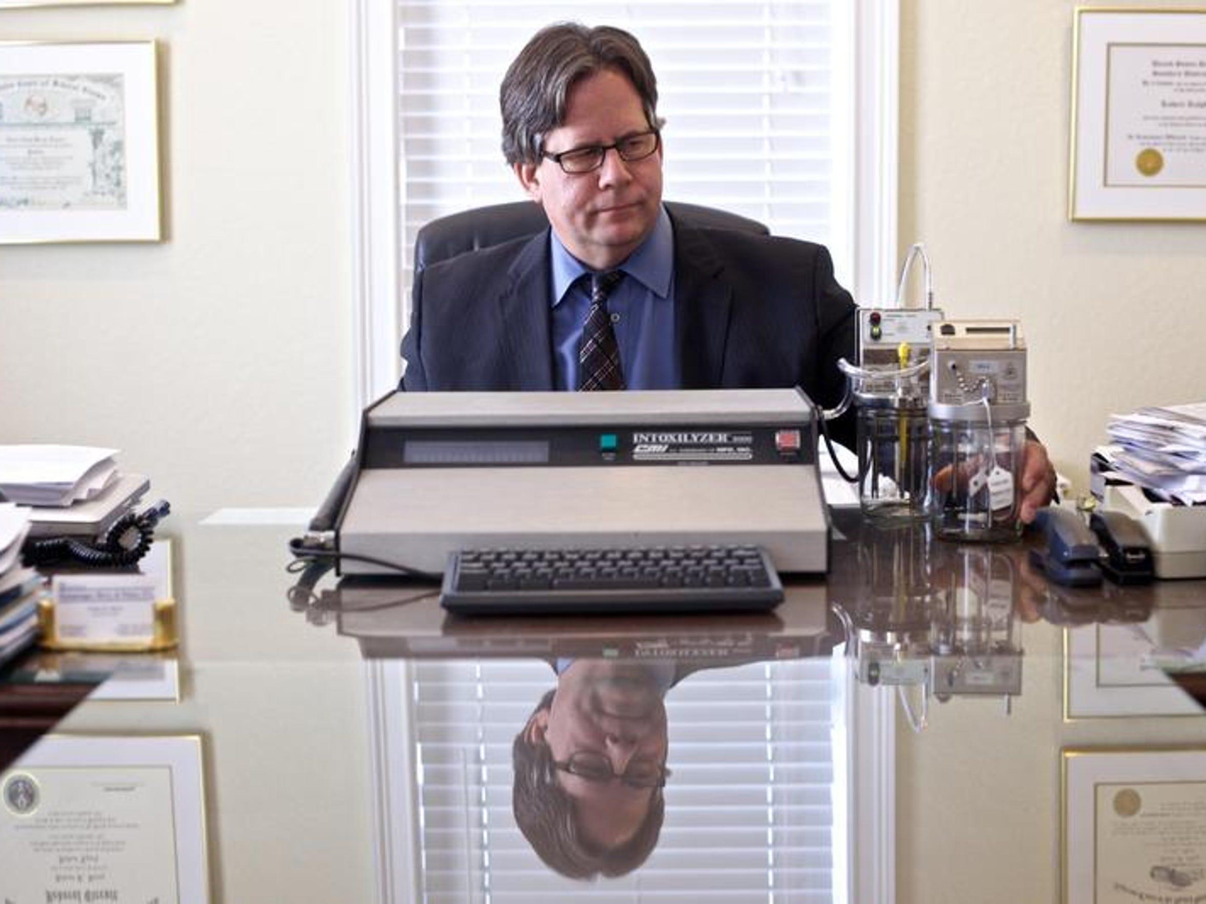 File: Robert Berry with a breathalyzer machine.